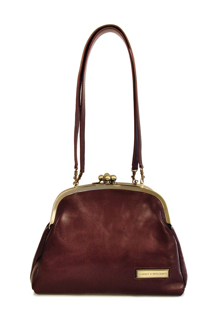 love this leather shoulder bag reminiscent of grandma's purse. rich leather and great hardware in a sweet shape