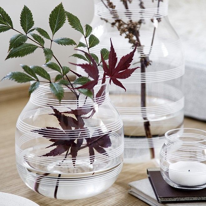 The clear Omaggio glass candle holder has a soft, chubby shape and is created in elegant, mouth-blown glass. The glass gives the design a new dimension when the light shines through the walls of the holder. The contrast between the fine, graphic stripes and the lovely translucent material results in an amazing look. See the beautiful glass candle holders in clear glass, deep plum and cool steel.