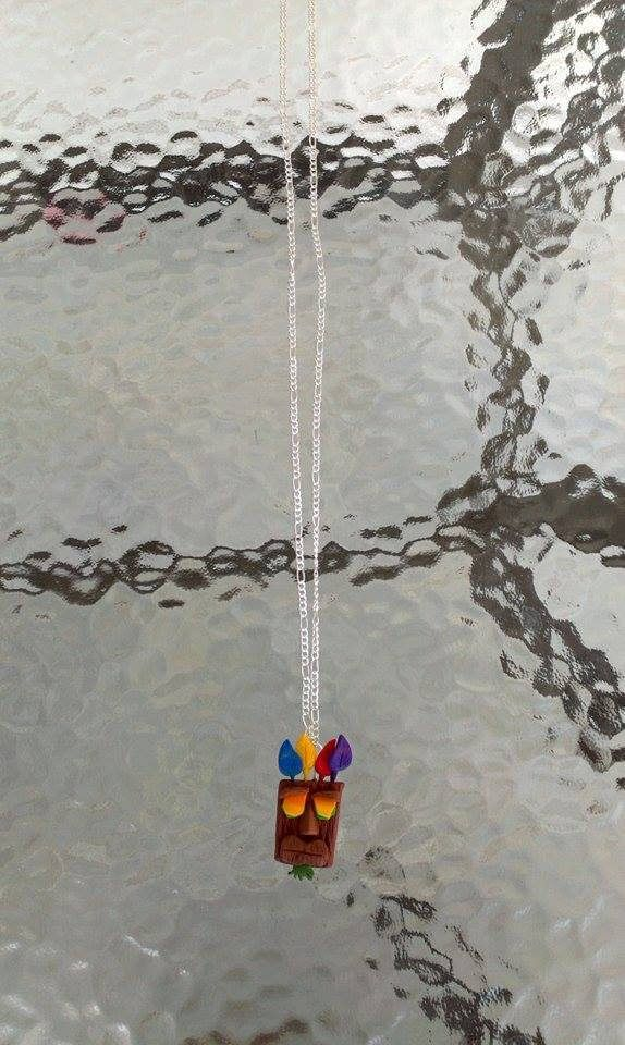 A polymer clay necklace inspired from the game Crash Bandicoot