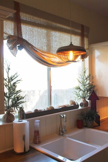 Holiday Home Tour, Christmas kitchen decor. Small burlap wrapped trees on window seal. Chevron burlap ribbon to gather up  roman shades Theraggedwren.blogspot.com