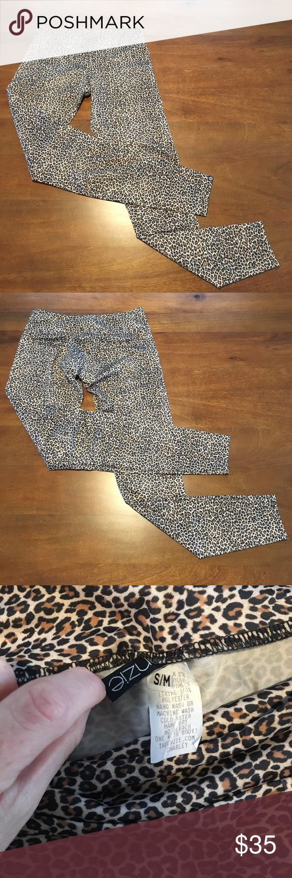 Onzie Long Cheetah Legging Onzie Long Cheetah Legging size Small/Medium.  Super cute and looks really great with boots!  Washed in cold and hung to dry always.  In great shape!  Please contact with questions.  No trades. Onzie Pants Leggings
