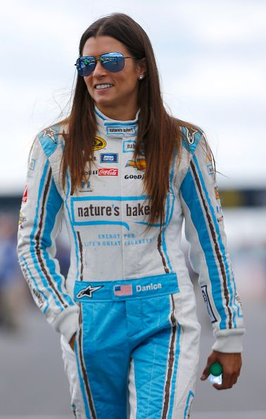 Danica Patrick driver of the Nature's Bakery Chevrolet stands on the grid prior to qualifying for the NASCAR Sprint Cup Series CheezIt 355 at Watkins...