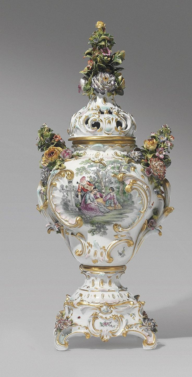 A GERMAN PORCELAIN FLOWER-ENCRUSTED POT-POURRI VASE AND COVE