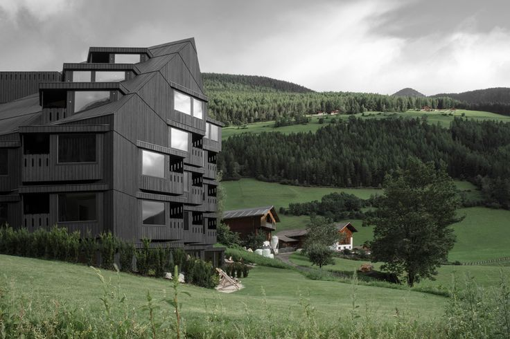 Pedevilla Architects adds angular blackened-larch extension to hotel in South Tyrol