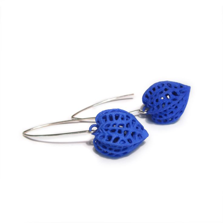 These lightweight physalis earrings were designed on the computer and 3D printed in nylon The pods measure 21 mm 0 8 inches long by 17 mm 0 67 wide and the earrings hang 5 cm long 2 inches The wires are sterling silver and made of recycled argentium sterling silver They will come with clear rubber