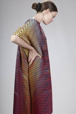 Issey Miyake | calf-length dress in baked-stretch polyester plissé with multicolored horizontal and diagonal lines | #isseymiyake