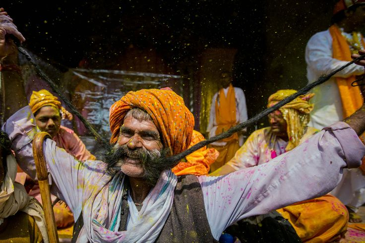more long mustache in the holy festival. Very vibrant and full of life, great shot and an excellent portrait with a stunning mustache! -