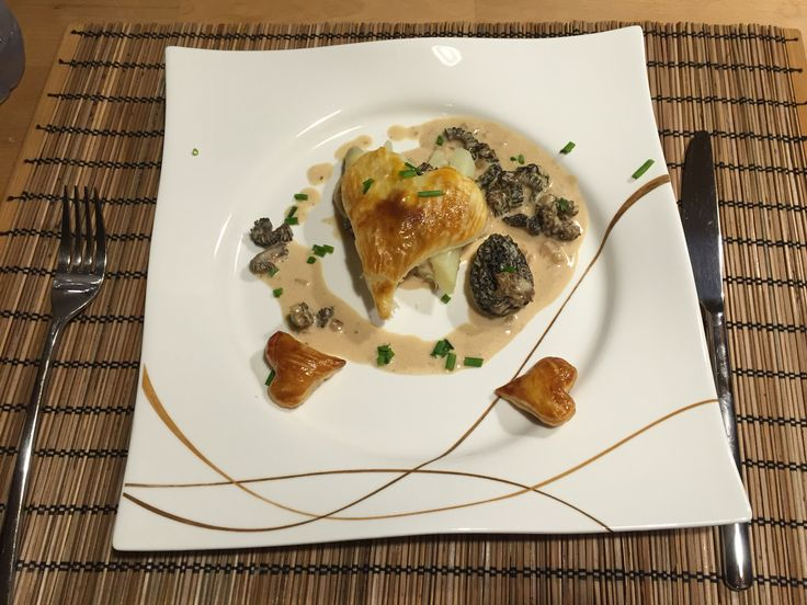 asparagus on morel sauce with flaky pastry