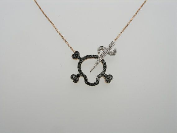 This scull necklace is made of sterling silver and is set with cubic zircon by hand. A special scull necklace with a sword on it. Trendy and artistic at the same time ideal for special occasions. It hangs on a sterling silver chain and is 17inches from end to end. (45cm)If you want a different length let us know in notes to seller. Its dimensions are 0.70×0.70 inches aproxx.