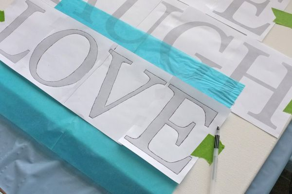 I have done this several dofferent ways. This is a gret tutorial using Chacopaper transfer paper for large quotes on canvas