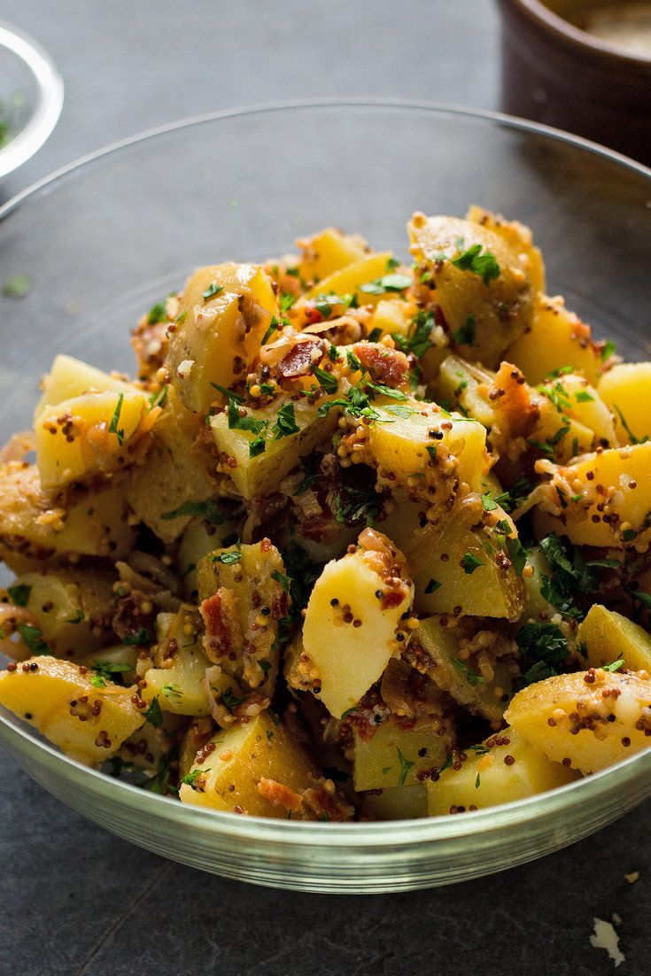 NYT Cooking: The German-style potato salad doesn't contain any mayonnaise, but is rich with bacon, whole-grain mustard and sweet fried shallots. It's best served warm while the bacon still glistens with fat, but is also nice at room temperature. Make it as close to serving time as possible. Or if you do make it ahead, consider popping it into the microwave for a minute or so just...