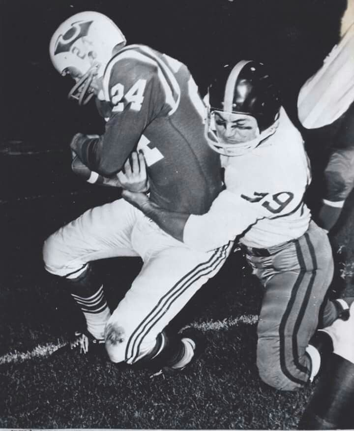Boston Patriots - New York Titans AFL action at Nickerson Field - November 11, 1960  Boston TE Joe Johnson (wearing the original Patriots logo) being taken down by Titans safety Fred Julian.