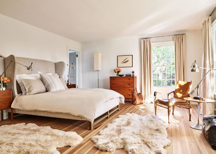 an eclectic mix of modern furnishings and a statement headboard in this neutral bedroom | house tour via coco kelley