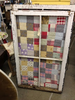 Framing a quilt using an old window.