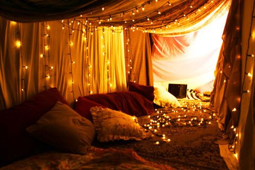 Draped and fairy lights all along a hallway - you have to push back the drapes to find the doors