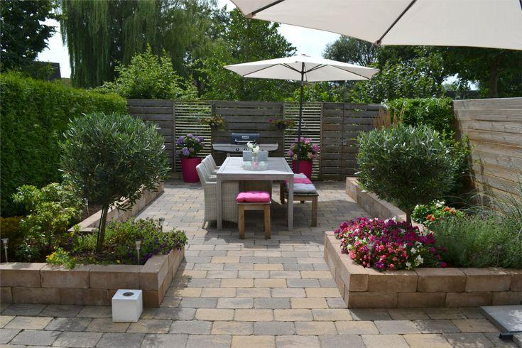 Strakke tuin, onderhoudsarm, verhoogde borders en sierbestrating