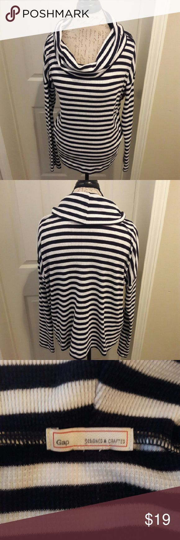Gap - striped cowl neck shirt In perfect condition. Like new. Gorgeous navy and white stripes long sleeve top. Nice and warm. Great soft material. Perfect for winter. This is a slouchy top. Has a lot of room. Not form fitting. Super cute! From a smoke and pet free home. Fast shipping!  *No trades *All offers considered  *I take offers on bundles and single items GAP Tops