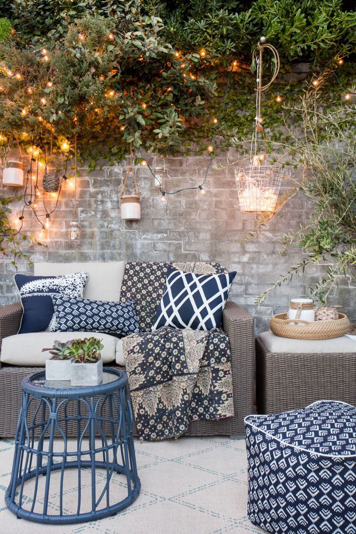 outdoor string lights, hanging lanterns and lots of pillows and poufs