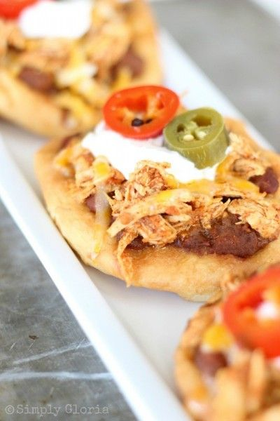 Shredded chicken and salsa mixed in with each other to cover a bed of chili and refried beans. All put on top of a warm, fluffy fry bread. Melted cheese, and with a few of your favorite toppings, finishes this creation of The Chicken Fry Bread Taco. There are actually a lot of names to …