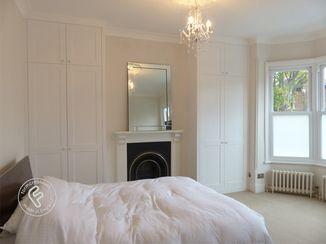 Fitted wardrobes to full ceiling height (2.9 metres in this shot)