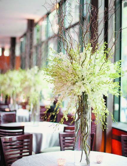 Great for a winter table scape.  I think I would frost the Branches in white glitter--or flock? Still thinking about this.  Freesia and willow branch centerpiece.