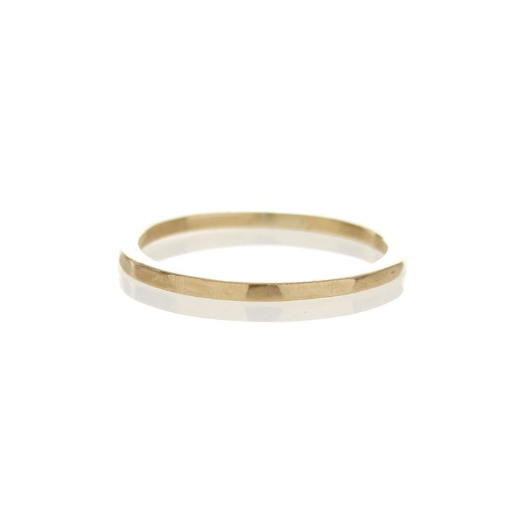 A simple 1,5mm gold band with faceted detail. Available in 9ct yellow or white gold.