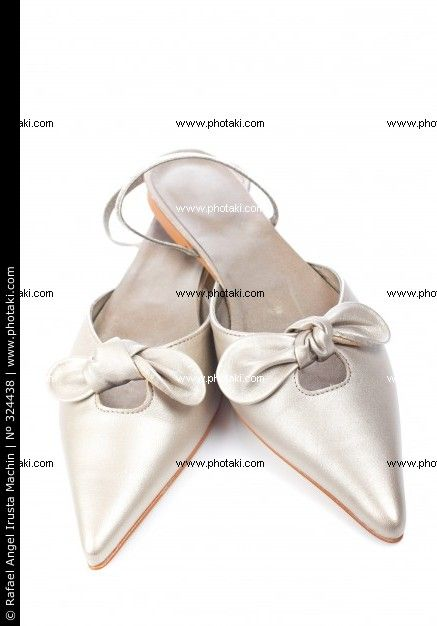 http://www.photaki.com/picture-wedding-shoes-isolated-on-white-background-with-soft-shadow-comfortable-married_324438.htm