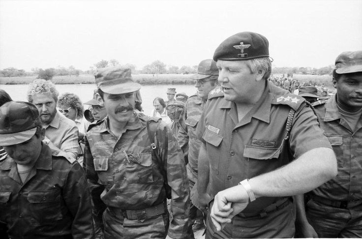 Col. Archie Moore leads the joint military monitoring commission on an inspection of the SADF built pontoon bridge crossing the Kavango river . With him are once enemies from Cuba, Russia, FAPLA . On this day and at this time Southern Africa would change forever. The SADF would withdraw, so too would the Cuban Fapla Plan forces. SWA/Namibia would then implement resolution 435 and the war would come to an end. Photo courtesy Outapi War Museum. Story for the South African Legion Peter Dickens