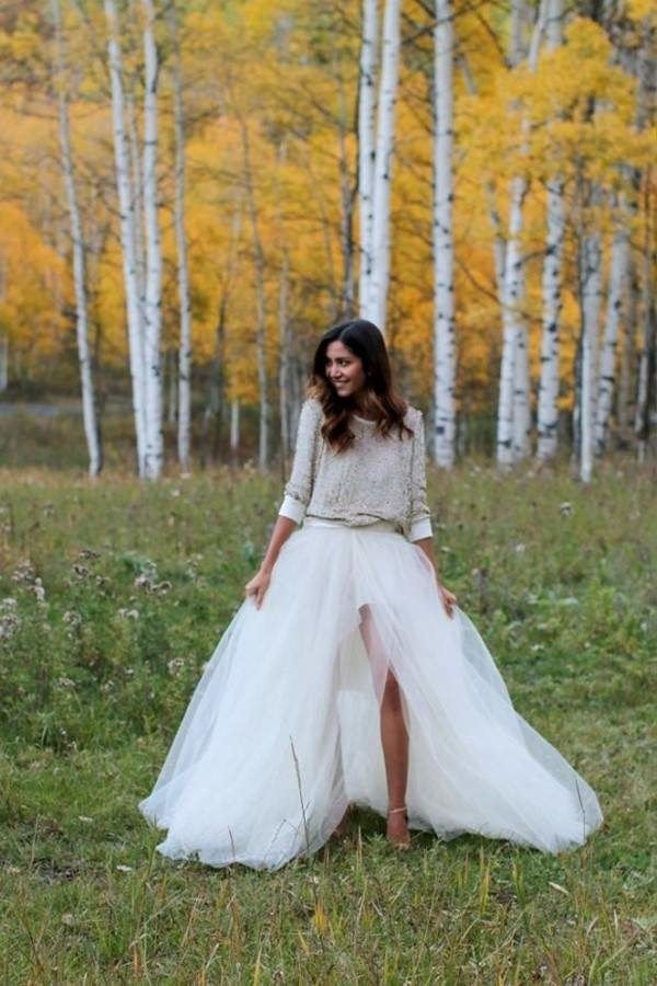For a fall wedding, pair a comfy sweater with a ball gown skirt for casual and sweet bridal style.