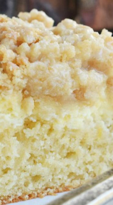 Lemon Crumb Cake ~ Sweet lemon cake with a lemon cheesecake filling, crumbly streusel topping and a lemon glaze