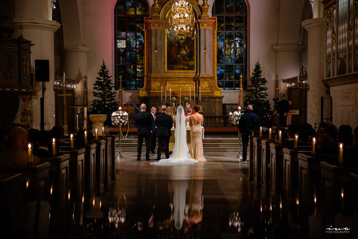 Assyrian wedding photo with the taken inside the mesmerising architecture of this old Swedish church in Jönköping called Kristine Kyrkan