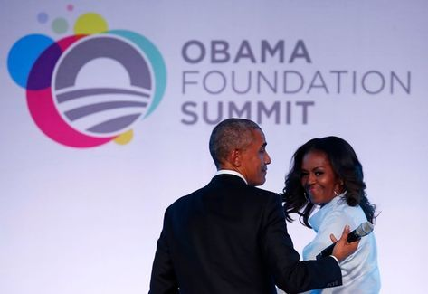 Michelle Obama Photos - Former US president Barack Obama and his wife Michelle walk off the stage at the Obama Foundation Summit in Chicago, Illinois, October 31, 2017. / AFP PHOTO / Jim Young - Michelle Obama Photos - 15 of 9409