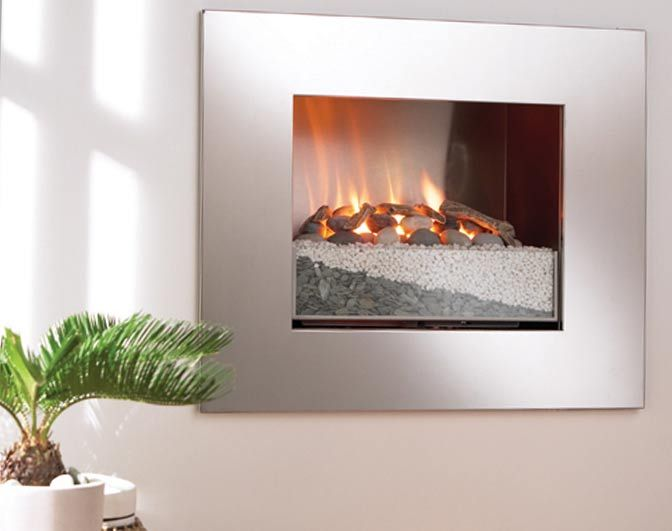 Firestrata - This modern gas fireplace design is surrounded by a minimal steel frame, completing the hole in the wall look.