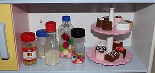 Spice containers with assorted sensory items in them.  Put in the kitchen area for 'cooking'.