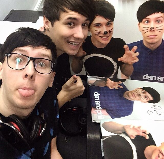 Dan and Phil signing posters :) ❤️ (WHY ARE THEY SO PERFECT??)