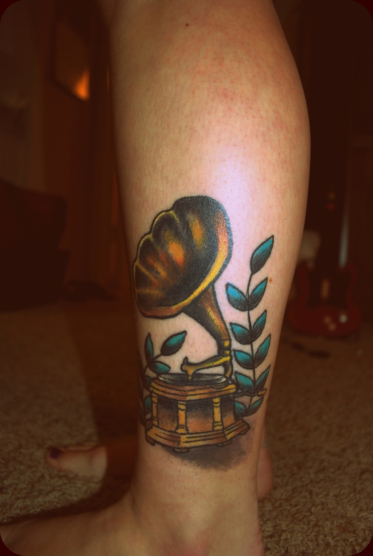 """This tattoo was inspired from the Tegan & Sara song 'I Won't Be Left'. I chose a gramophone because 1) I'm a fan of antiques from the early 1900s era and 2) one line from the song is, """"I won't be left dancing alone to songs from the past"""". It symbolizes how I interpreted the song along with my connection to it.  Artist: Johnny Jackson @ Texas Body Art"""
