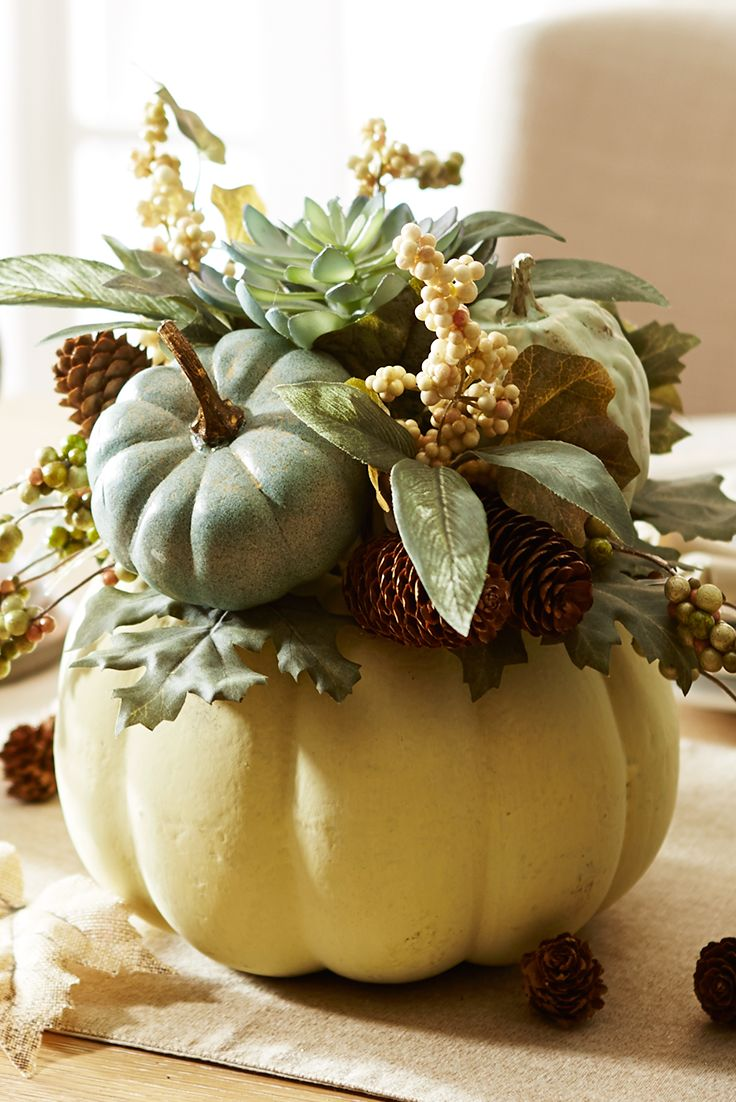 Handcrafted exclusively for Pier 1 to charm every guest to your home this season, this Faux Pumpkin Floral Arrangement features a white pumpkin potted with faux succulents, berries, natural pinecones and more pumpkins. Gather it in.