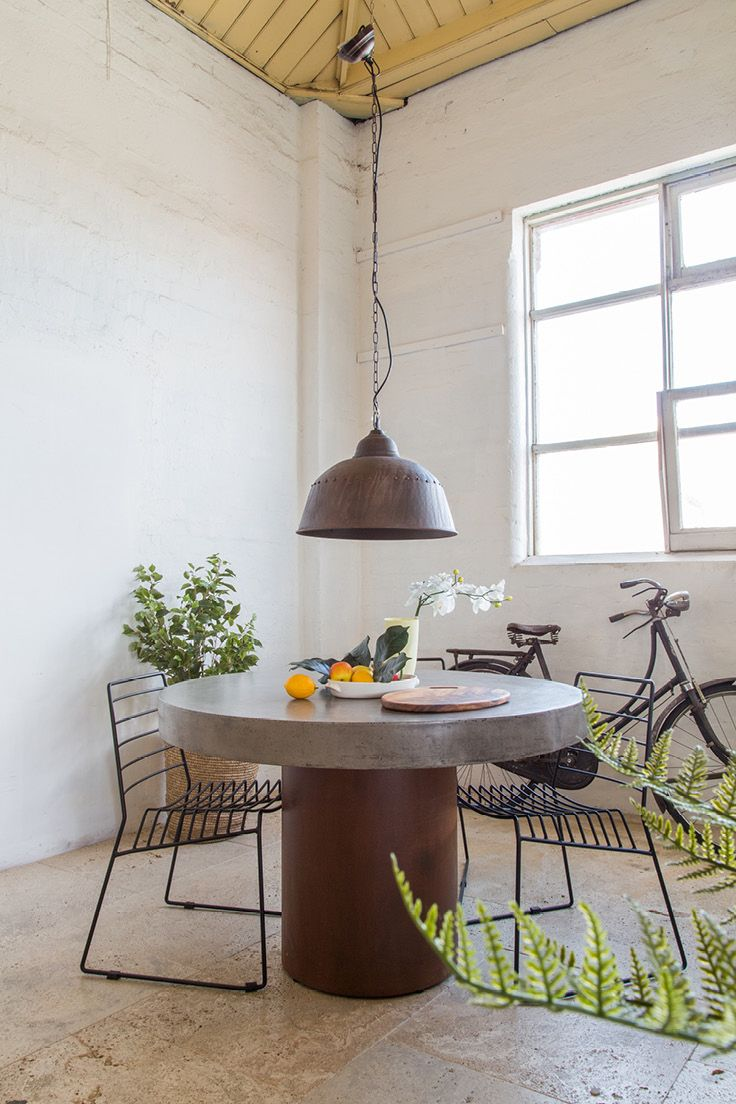 Regent Concrete Round Table Indoors & Outdoors // Laika Steel Chair // Artois Copper Patina Light // Buy it all at Schots Melbourne, Australia