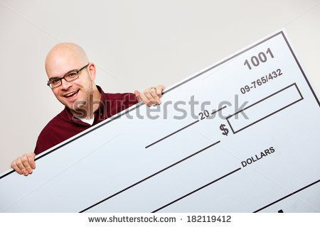 man holding check | Check: Excited Man Holding Up Oversized Blank Check - stock photo. waving this in front of me across library as if mocking that they have it