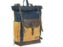 Navy blue and yellow waxed canvas rucksack.