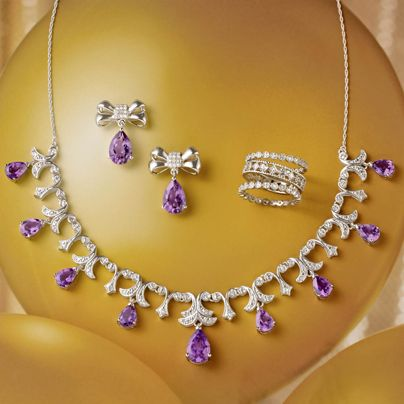 A Regal Look! Amethyst & Diamond Bow Earrings. Go formal or casual in these versatile bow ties. Sterling silver with pear-shaped amethysts and diamonds. This antique-inspired Amethyst and Diamond Necklace presents pear-shaped amethysts and diamonds in a dramatic, draping style. Set of Three White Topaz and Diamond Eternity Bands. >>Click on the pin to shop Amethyst Jewelry.  #amethyst #diamond #gemstone #necklace #earrings #ringset #RossSimons