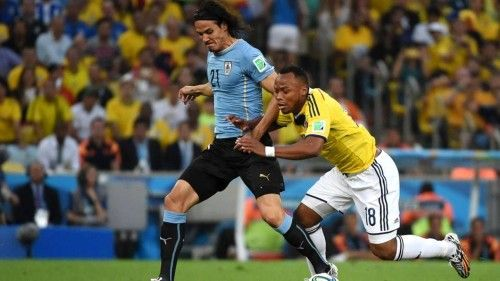 Edinson Cavani Uruguay and Juan Zuniga Colombia Vie For The Ball at World Cup 2014 .. http://sdgpr.com/edinson-cavani-uruguay-world-cup-2014.html