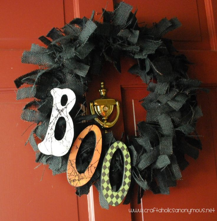 BOO wreath TUTORIAL wreath is made from burlap strips tied around a Styrofoam wreath form that had been painted black. The letters are wooden covered with Mod Podged Halloween papers. Click on the photo to see a complete step by step tutorial. Note: you could also use deco mesh ribbon like this: shop.hobbylobby.c...