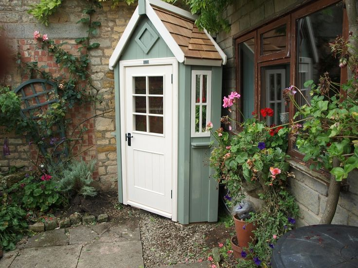 Bespoke corner potting shed with two tone paint posh for Bespoke garden sheds