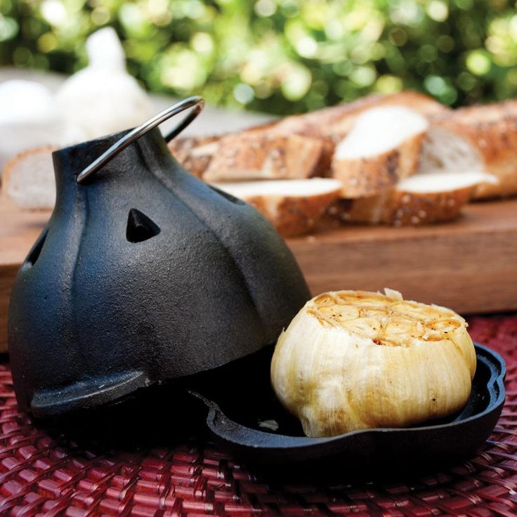 Make freshly roasted garlic for your homemade pizza. Just drizzle some olive oil with some salt and pepper and roast in the oven or grill for about 45 minutes.  This Charcoal Companion Cast Iron Garlic Roaster