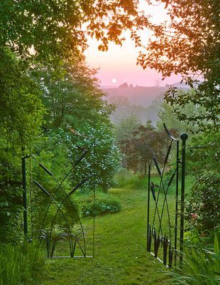 Grass path leading through iron gates | Taken at dawn by Clive Nichols