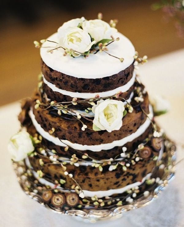 You can add both visual and taste profile interest to an unfrosted cake by using non-traditional wedding cake flavors for your layers, like cinnamon chocolate chip or cardamom spice. Weave in some chocolate chip (or carob chips), berries or other cake inclusions like coconut pieces to add texture and color to the cake itself.
