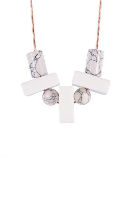 The Beck Rose Gold and Marble necklace.  Simple and stunning.