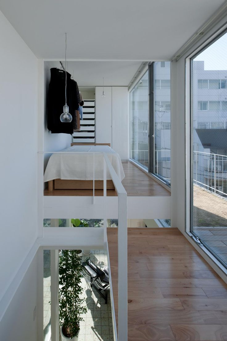 connected with stairways or elevated upon a platform, the interior of this dwelling opens up vertically with a visible spiraling of successive rooms around a single column.