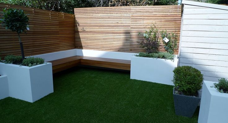 Image result for artificial grass and decking in concrete courtyard